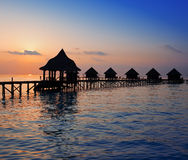 Silhouette of lodges in the sea at sunset. Maldives Royalty Free Stock Photography