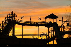 Silhouette of log flume vintage by sunset glow Royalty Free Stock Photos