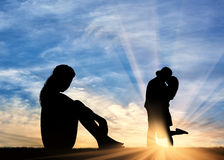 Silhouette  lonely woman looking at loving couple Royalty Free Stock Image