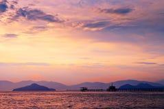 Silhouette of  long bridge to pagoda of temple & x22;Wat Koh Phayam& x22; Stock Image