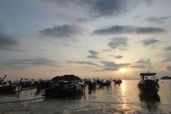 Silhouette of longtail Boat at Sunrise Beach, Koh Lipe island, T Stock Photo