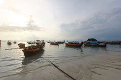 Silhouette of longtail Boat at Sunrise Beach, Koh Lipe island, T Royalty Free Stock Image
