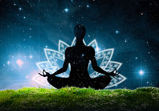 Silhouette of lotus yoga position Royalty Free Stock Image