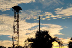 Silhouette of Loudspeakers broadcast tower. On the background sunset sky Stock Photography