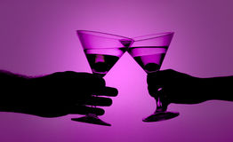 Silhouette of a love couple proposing a toast. Royalty Free Stock Image