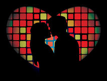 Silhouette of lovers. In front of the luminous mosaic heart shaped window Stock Images