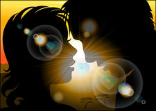 Silhouette of lovers on a background of the  sun Stock Photo