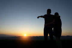 Silhouette lovers Hands up against sunset Royalty Free Stock Photo