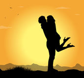 Silhouette of lovers Stock Photos