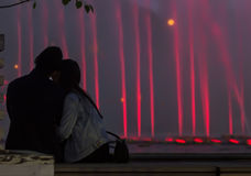 Silhouette of loving couple on background of fountains Stock Photos
