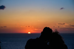 Silhouette of a loving couple on the background of the setting sun, islands and sea. Santorini. Greece. stock image