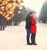Silhouette of loving couple embracing in warm winter day Royalty Free Stock Images