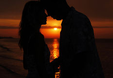 Silhouette of a loving couple at sunset. A silhouette of a loving couple at sunset Royalty Free Stock Photography