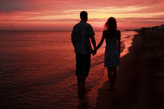 Silhouette of a loving couple at sunset Stock Photos