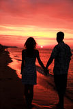 Silhouette of a loving couple at sunset Stock Photography