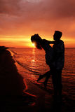Silhouette of a loving couple. At sunset Royalty Free Stock Photos