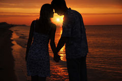 Silhouette of a loving couple. At sunset Stock Photography