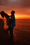 Silhouette of a loving couple. At sunset Royalty Free Stock Image