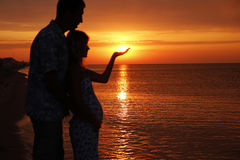 Silhouette of a loving couple at sunset. A silhouette of a loving couple at sunset Royalty Free Stock Images