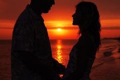 Silhouette of a loving couple at sunset. A silhouette of a loving couple at sunset Royalty Free Stock Photos