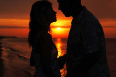 Silhouette of a loving couple at sunset Royalty Free Stock Images