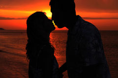 Silhouette of a loving couple at sunset Stock Images