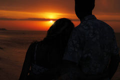 Silhouette of a loving couple at sunset. A silhouette of a loving couple at sunset Stock Photo