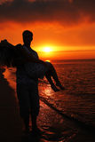 Silhouette of a loving couple at sunset Royalty Free Stock Image