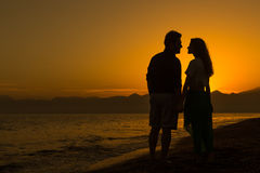Silhouette of Loving Couple at Sunset Stock Photography