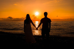 Silhouette of a loving couple at sunset Stock Image