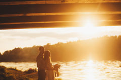 Silhouette of a loving couple. At sunset. Summer Royalty Free Stock Photography