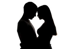 Silhouette of loving girl and boy Stock Image