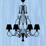 Silhouette of luxury chandelier on a scratched blue wallpaper Stock Photography