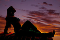 Silhouette on magic carpet sit Stock Images