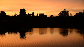 Silhouette of the Main Temple Buildings with Lake Reflection at Sunrise - Angkor Wat, Cambodia stock footage