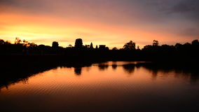 Silhouette of the Main Temple Buildings with Lake Reflection at Sunrise - Angkor Wat, Cambodia stock video