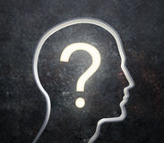 Silhouette of a male face with a glowing question. 3D silhouette of a male face with a glowing question mark royalty free stock image