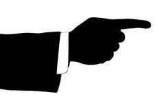 A silhouette of a male hand pointing his finger Stock Image