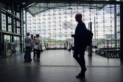 Silhouette of male traveller at Berlin Hauptbahnhof. A silhouette view of a man wearing a suit and carrying a light backpack at Berlin Central station Stock Image