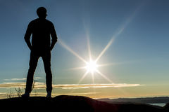 Silhouette male watching the sunset in Bergen Norway Stock Photos