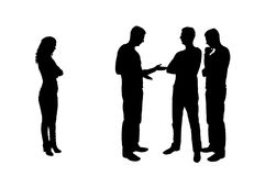 Silhouette of male workers together at a meeting, a woman stands aside stock image