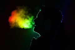 Silhouette of a man. Colored outline of a man exhaling warm breath Stock Photo