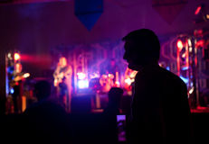 Silhouette of a man. In public concert stock images