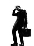 Silhouette  man. Silhouette caucasian business man  expressing fatigue despair tired behavior full length on studio isolated white background Royalty Free Stock Photos