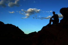 Silhouette of a man. On mountain top Stock Photo