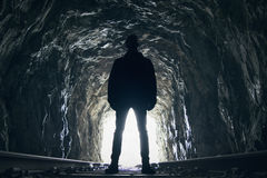 Silhouette of man in abandoned railway tunnel Stock Photos