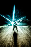 Silhouette of man with abstract light effects Stock Images