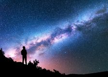 Silhouette of man against night sky with Milky Way Stock Photo