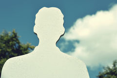 Silhouette of man against the sky with clouds in vintage style ( Stock Photo