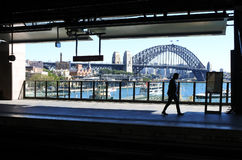 Silhouette of a man against Sydney Harbour Bridge in Sydney Aust Royalty Free Stock Photography